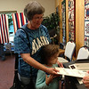 Primary election in Alaska.  Helping grandmother put in her ballot.