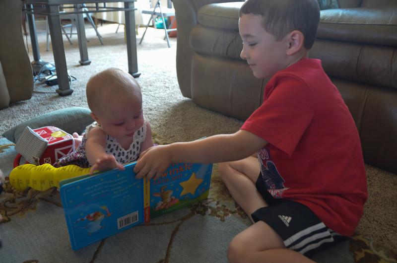 BRADEN READING TO OLIVIA