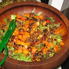 salad with roasted yams, squash, onions, carrots, candied pecans, cranberries, goat cheese