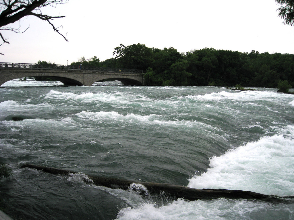Pedestrian bridge over the Niagara River to Goat Island just upstream of the falls.  The amount of water is impressive.