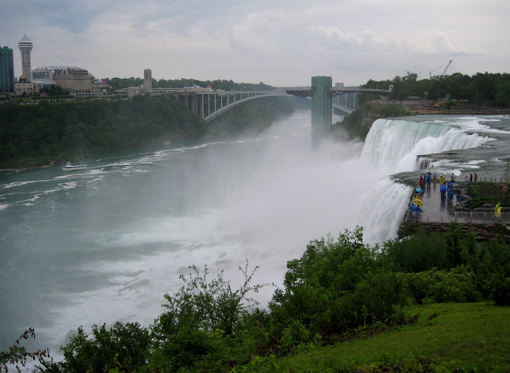 American Falls from the Goat Island observation deck.  Rainbow Bridge to Canada in the background.