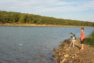 Boys Throwing Rocks Into the Lake