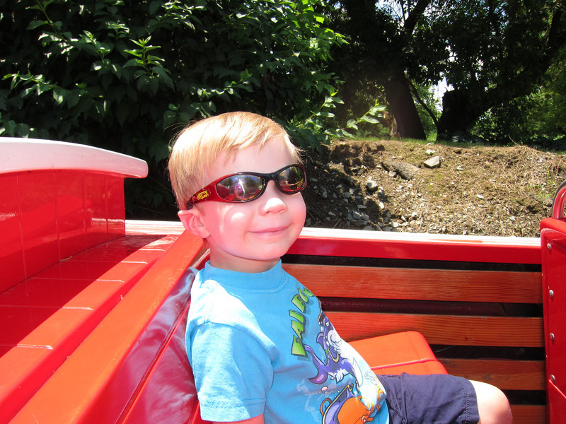 Relaxing on a lazy river boat ride at Dutch Wonderland.  Ethan enjoyed seeing the ducks!