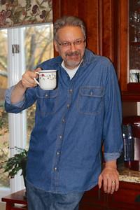 Steve raises a toast with his DECAF tea.