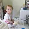 Sienna loves helping in the kitchen
