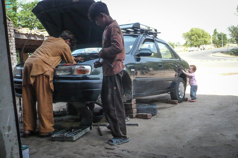 On our way to Lahore our car broke down. Sienna was helping the mechanics as they disassembled our transmission on the side of the road.