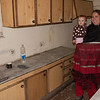 Erin shows off the kitchen