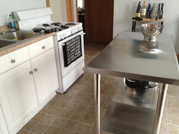 The stainless steel kitchen prep table is new (and a gift from my Aunt Liz). I needed more counter space, so it was either something like this or an island with a butcher block top. This actually looks really good with the stainless fridge.