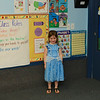 Showing me around her preschool room