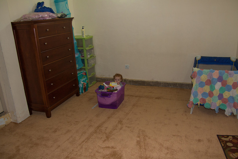 This is actually in our house in Pindi, right before we left. The purple toy box has wheels on the bottom and Sienna loves it when we push her around in it.
