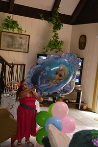 The balloons are bigger than Izzy iz.