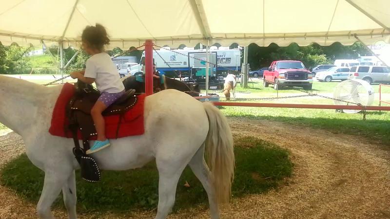 riding a pony at the howard county fair