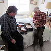 Ken and Frank in Frank's bedroom looking at Frank's old stamp collection, 2/23/2014