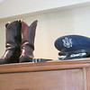 Sue's old boots and Dad's Air force dress hat, in their place of honor.  Dad spent many many hours shining that particular pair of cowboy boots