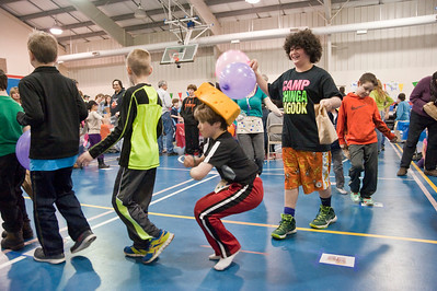 Eric Jenks - The Saratogian Children dance in a circle during the annual Purim festival celebration at the Gavin Park Rec. Center Sunday, March 16, 2014.