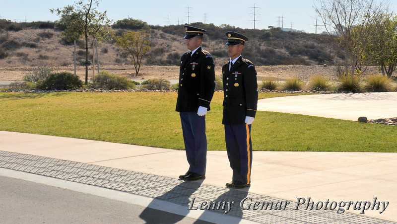 Out at the ceremony site the Army Honor Guard begin the ceremony.