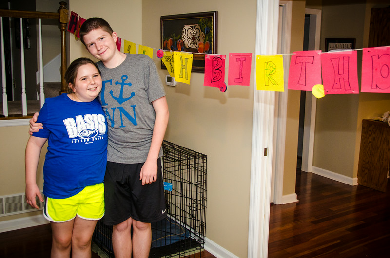 8.11.2014 - Connor on his 14th birthday with his sister and the fantastic sign she made for him.