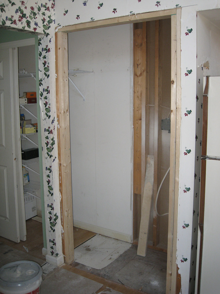 Old ovens gone, and wall cut out for new pantry.