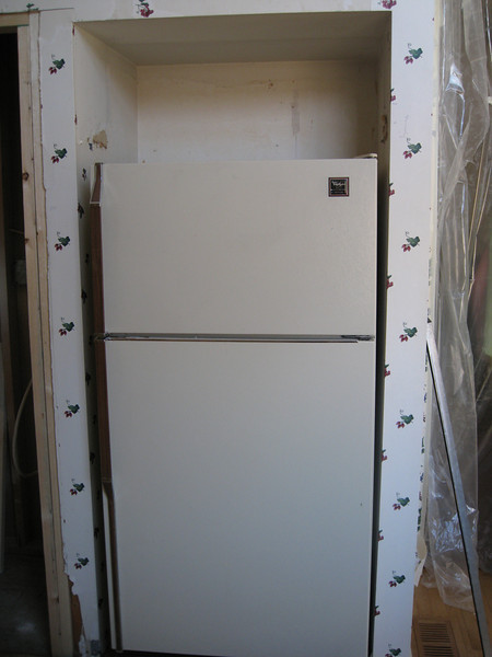 Cabinet over the fridge is gone, and will be replaced with a taller, deeper cabinet.  The fridge stays plugged in and working until the new one arrives.