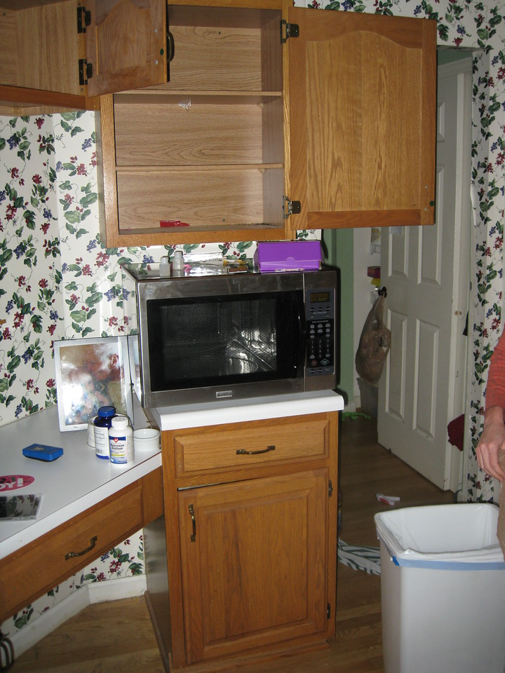 Microwave - Before.  This is where the new ovens will go.  I'll be glad to get rid of the crappy, press-board cabinets clad in wood-look decals.
