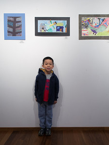 Nolan and his artwork at the Children's Art Festival