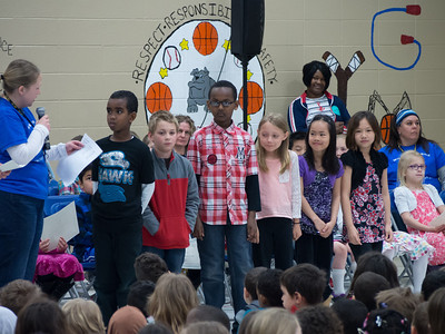 Lindsay getting REACH award in front of the whole school