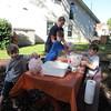 Bryan, Spencer, Jenny and Matthew making paper mache jack-o-lanterns, 10/19/2015