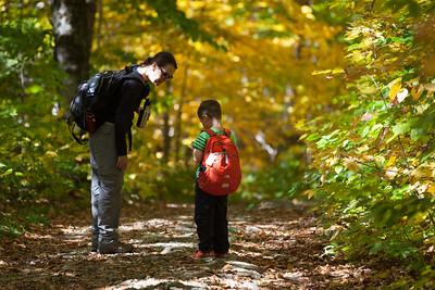 Nate checks his compass on the hike