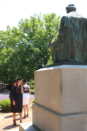 """Sara approaches """"Old Green Tom,"""" the statue of Thomas Green Clemson in front of Tillman Hall at Clemson University."""