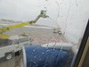 Plane at MSP before leaving for Phoenix 3/24/2015 - de-icing.  photo is all blurry because of the de-icer on the window and they were currently spraying the wings.
