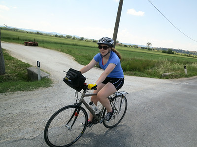Elizabeth pedaling stylishly through Italy