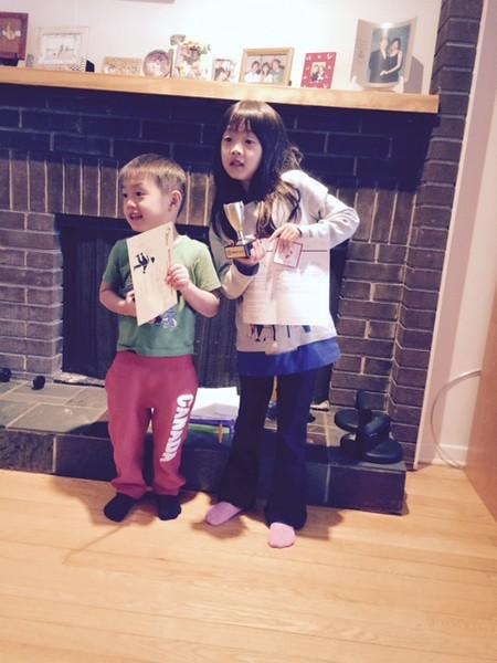 Hayden & Tiffany holding up Skating reports.