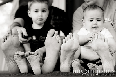 When we were a new family of three we took a photo our three sets of feet and it was interesting to see the comparison of our relative sizes.  Now that we are a family of four (and have been for nearly 6 months), I've been meaning to create this family feet portrait.  I love to take photos that give me a reference good to just how small they are now because I know it will change in the blink of an eye!