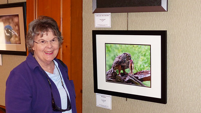 Jan with her photo entries at the Sun City Photo Club Exhibit