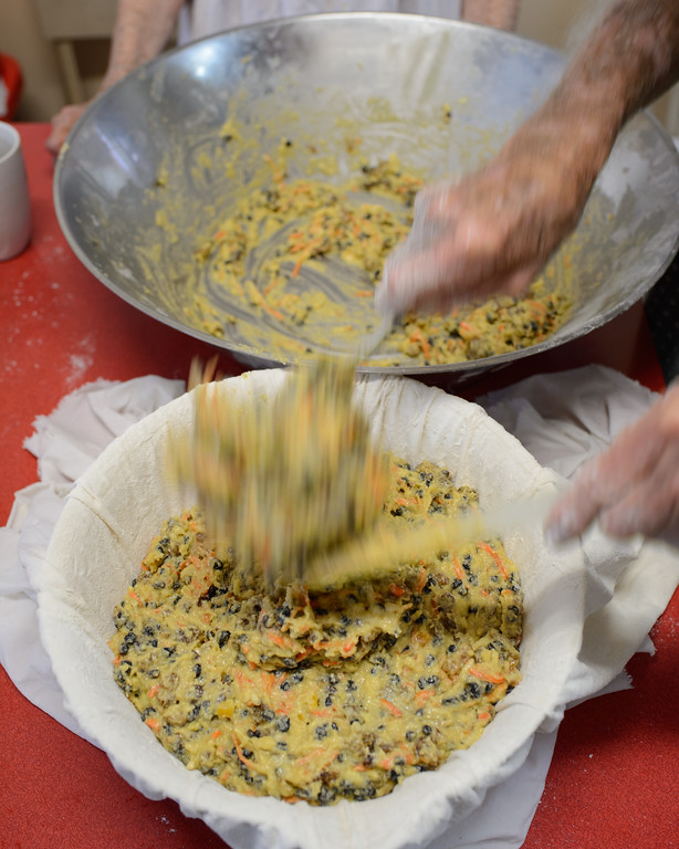 Transferring the pudding mix to the clean cloth sheet for cooking - Stage 2 / Day 2 - 2016 Christmas Pudding