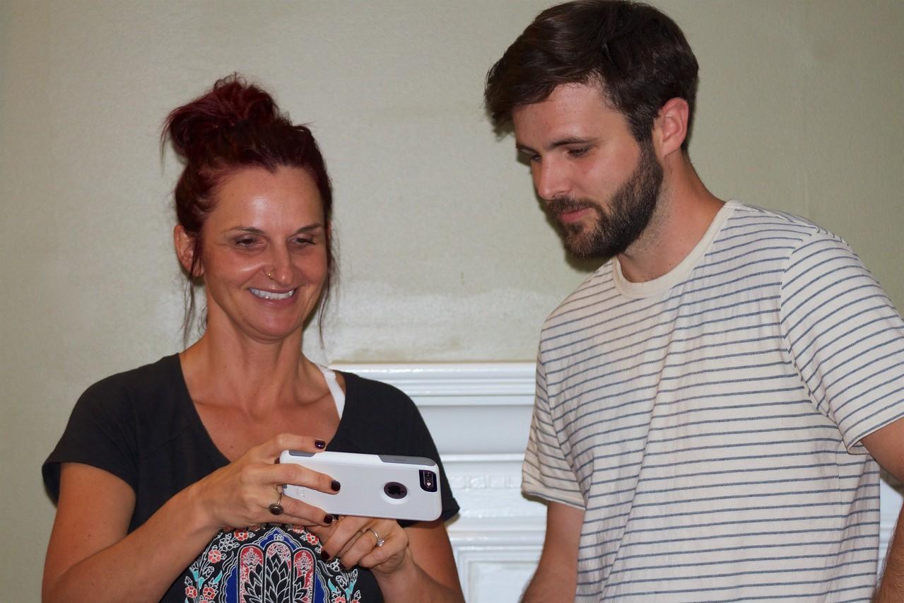 Rachel showing John her children
