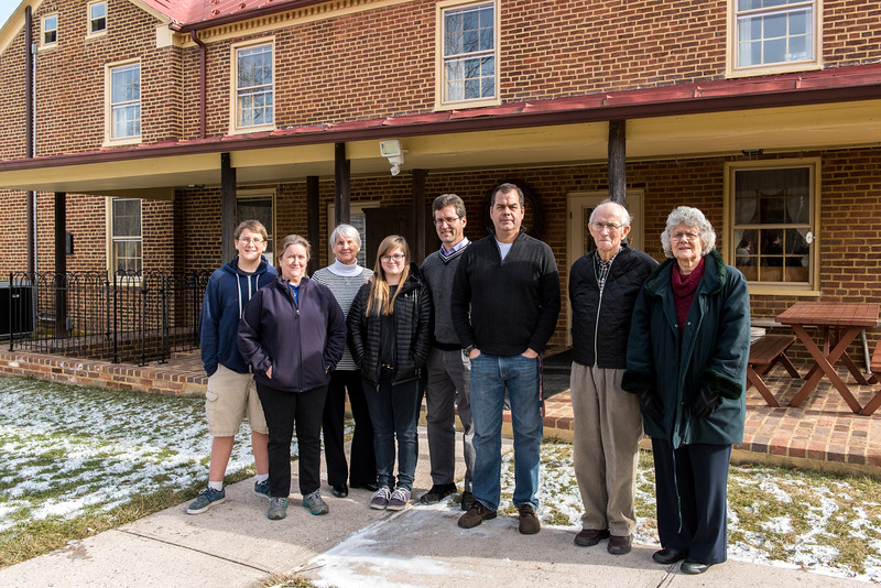 The extended Kotz family - Andy, Pam, Jack, Katie, Mara, David, Peter, Harold, and Carrollyn - in front of the Kotz home.