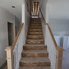 Love this staircase - SO happy we opened up the family room wall to match the hallway. And you can kinda see the railings up top.