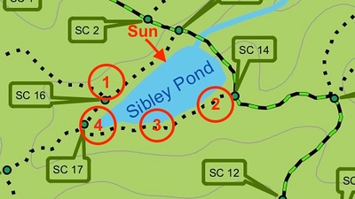 Sibley pond, with four shooting locations in late afternoon.