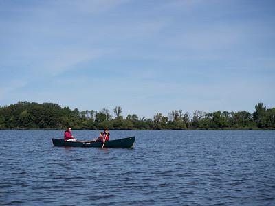 Jianping, Lindsay, and instructor paddling, learn to canoe program on Lake Monson