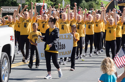 Lindsay and Jasmine holding the Burnsville Blazettes sign in the community parade