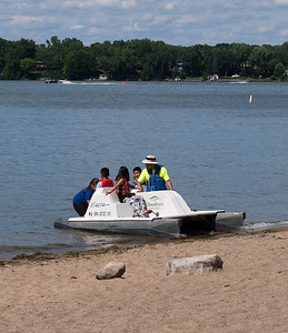 Launching a paddle boat on Lake Independence, Baker Park Reserve