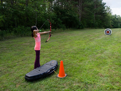 Lindsay taking aim, family archery at Cleary Lake Park