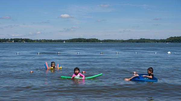 lindsay, Julia, and Jonathon floating in Lake Independence, Baker Park Reserve