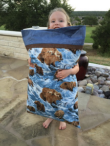Kenzie with the pillowcase she made! First sewing project!