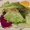 Salad made of local greens, shaved beets, preserved lemon, sauternes, candied millet.