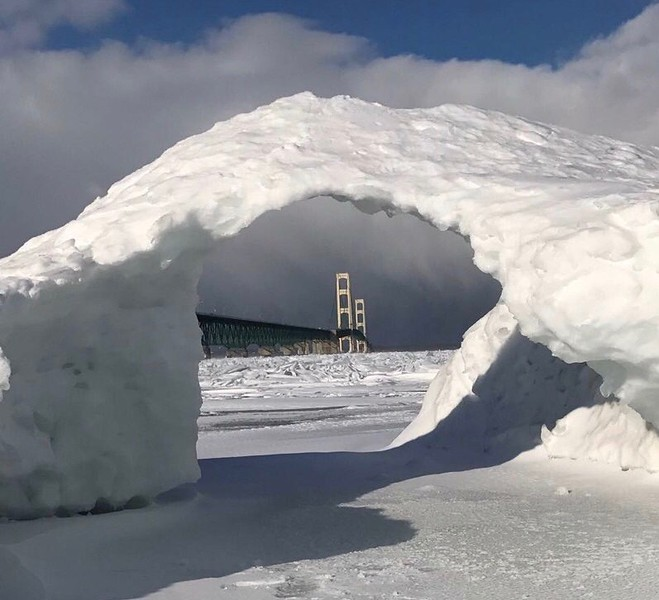 Meanwhile in Michigan - it's 18 degrees F.  Still funny!  Mackinac Bridge looking through a snow cave