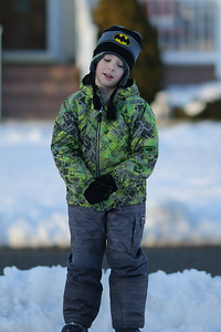 Ronkonkoma, NY; USA. Jason Bergmann plays in the snow in front of his home. Photo Credit: Chris Bergmann Photography
