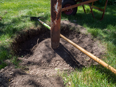 Pole is set in concrete block ~5 inches below surface