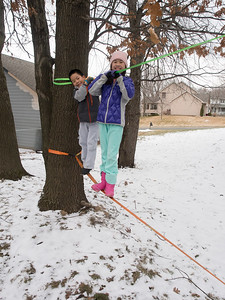 A little snow won't stop Lindsay and Nolan from trying out the new slackline